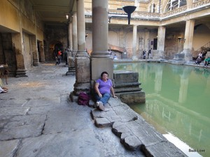 Testing the water at the Roman Baths, Bath, UK.